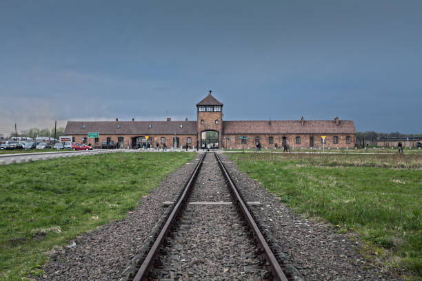 The main gate of the concentration camp. Wagon for the transport of prisoners. Transport of Jews from the ghetto. – zdjęcie