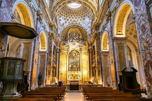 Rome, Italy, February 24 -- A view of the main nave inside the church of St. Louis of the French, near Piazza Navona. Built between 1518 and 1589 on plans by the architect Giacomo Della Porta, the church was consecrated on 8 October 1589. St. Louis of the French is considered the church of the French in Rome, particularly dedicated to the figure of King St. Louis IX. The church is also very famous and visited for the presence of some paintings on the life of St. Matthew by Caravaggio. Image in High Definition format.