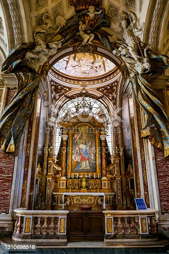 Rome, Italy, April 01 -- The majestic chapel dedicated to St. Louis inside the church of St. Louis of the French, near Piazza Navona. Built between 1518 and 1589 on plans by the architect Giacomo Della Porta, the church was consecrated on 8 October 1589. St. Louis of the French is considered the church of the French in Rome, particularly dedicated to the figure of King St. Louis IX. The church is also very famous and visited for the presence of some paintings on the life of St. Matthew by Caravaggio. Image in High Definition format.