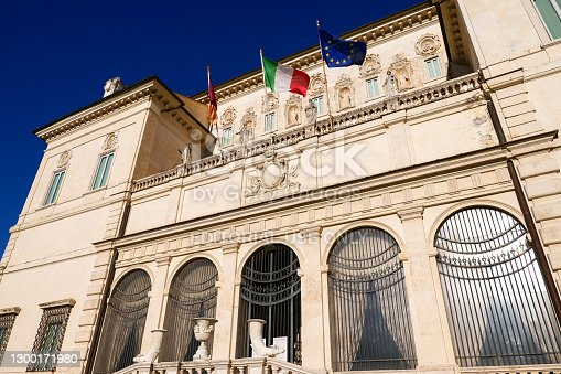Rome, Italy, January 16 -- The majestic facade and main door of the Borghese Gallery in the Villa Borghese park, in the green heart of Rome, near the Pincio Gardens. The Italian State Museum of the Borghese Gallery is famous for the presence inside it of priceless artistic treasures, with works by Canova, Caravaggio, Bernini, Titian and Raphael, among others. The neoclassical palace was built in 1607 by Scipione Borghese, cardinal and nephew of Pope Paul V. Image in High Definition format.