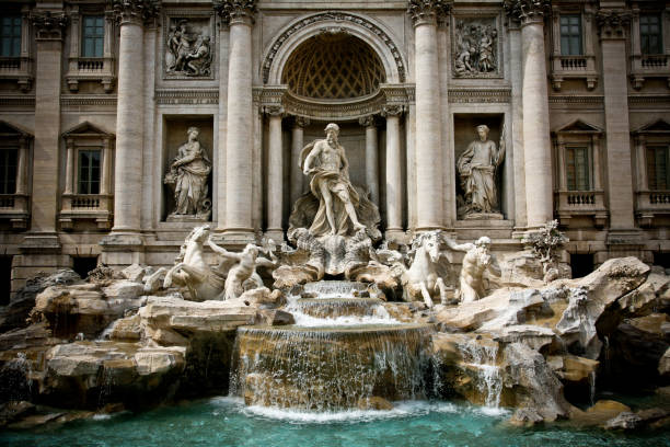 The majestic facade of the Trevi Fountain in the historic center of Rome through one of the most beautiful and ancient cities in the world. Fontana di Trevi ancient rome stock pictures, royalty-free photos & images