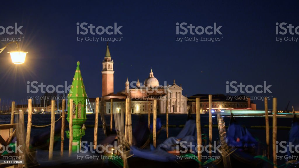 The majestic grand canal Venice with gandola setting scene for a cold evening. Venice Italy 2015 stock photo