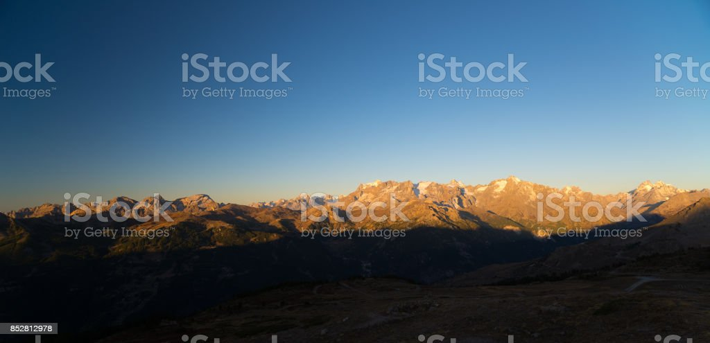 The majestic peaks of the Massif des Ecrins (4101 m) national park with the glaciers, in France, at sunrise. Clear sky, autumn colors. stock photo