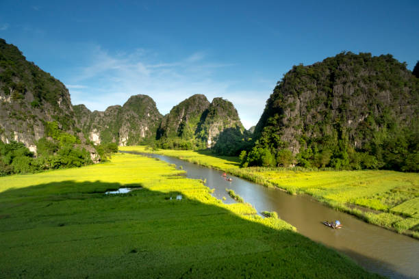the majestic scenery on Ngo Dong river in Tam Coc Bich Dong view from the mountain top in Ninh Binh province of Viet Nam stock photo