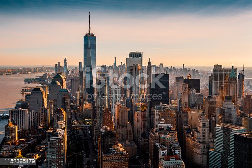 The vast skyline of Manhattan island taken from a helicopter at a golden hour.