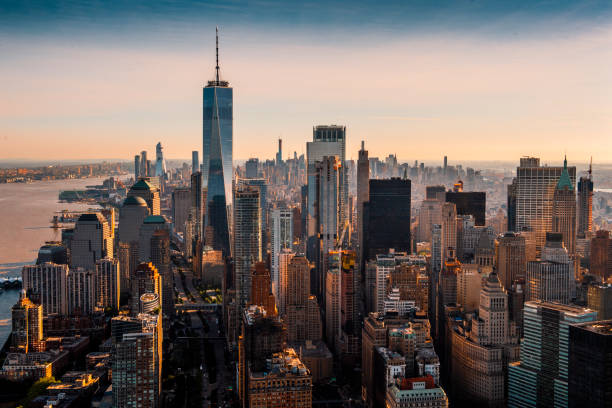 The majesty of Manhattan island taken from a helicopter above the downtown area at a golden hour The vast skyline of Manhattan island taken from a helicopter at a golden hour. new york state stock pictures, royalty-free photos & images
