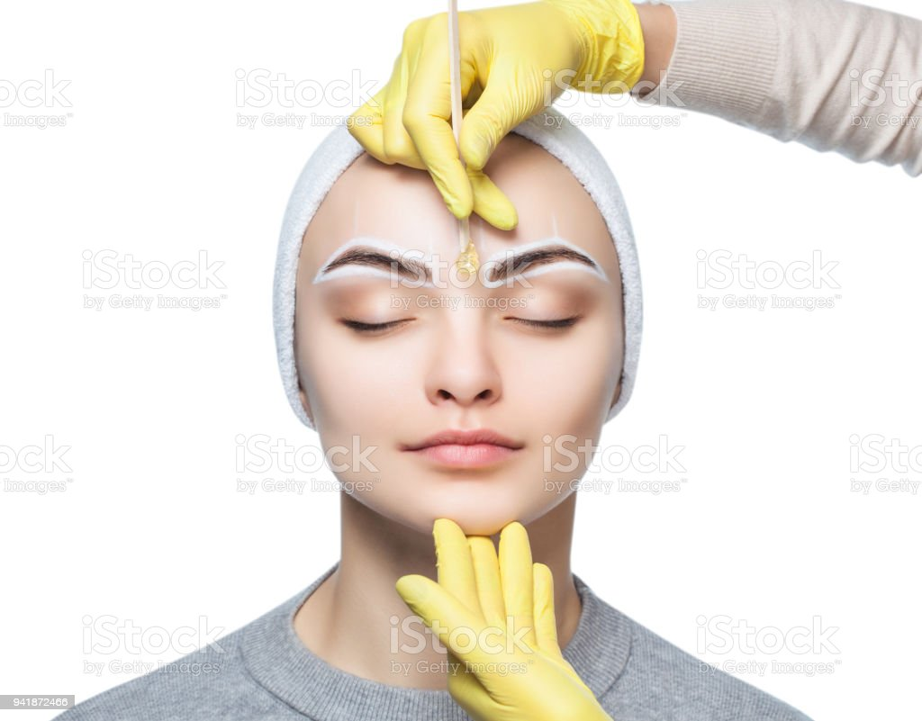 The Makeup Artist Plucks Her Eyebrows Before The Procedure Of
