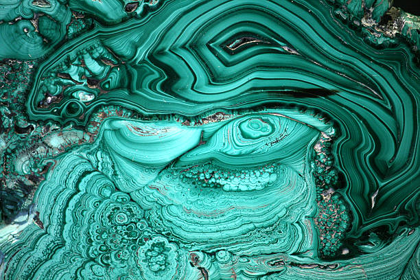 The Malachite Cut The cut of green malachite as a background malachite stock pictures, royalty-free photos & images