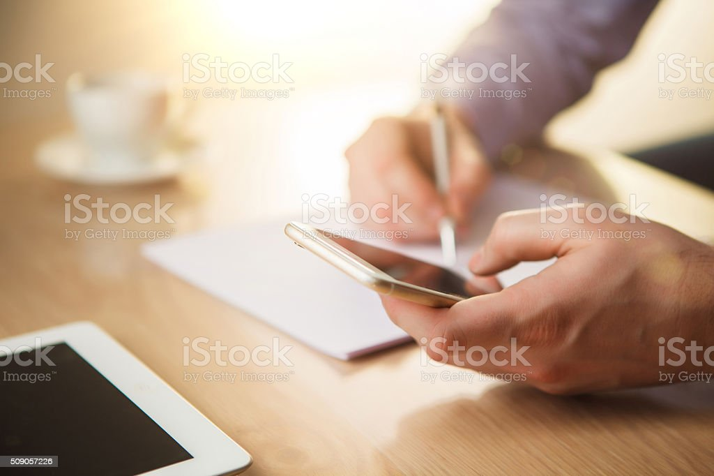 The male hand holding a phone stock photo