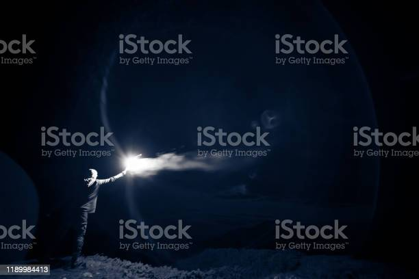 Photo of The male standing with a bright firework stick