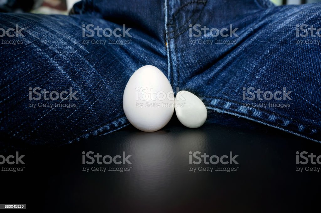 The male testicles, in the form of chicken egg stock photo