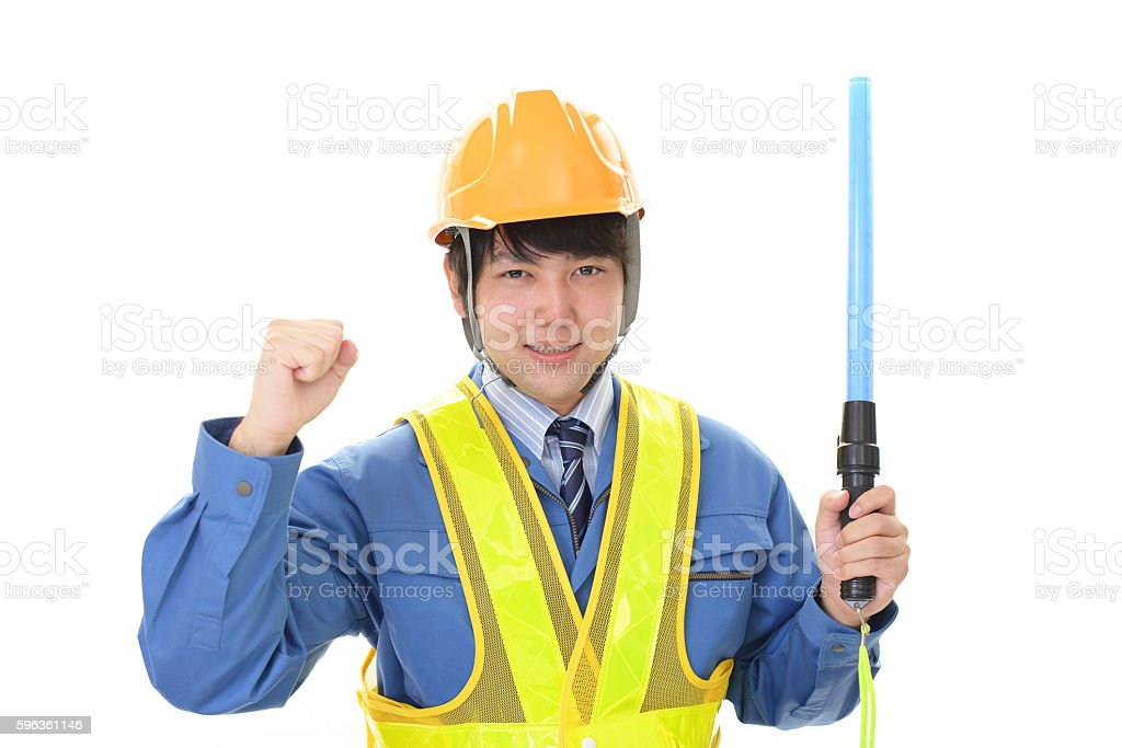 The male worker who poses happily royalty-free stock photo