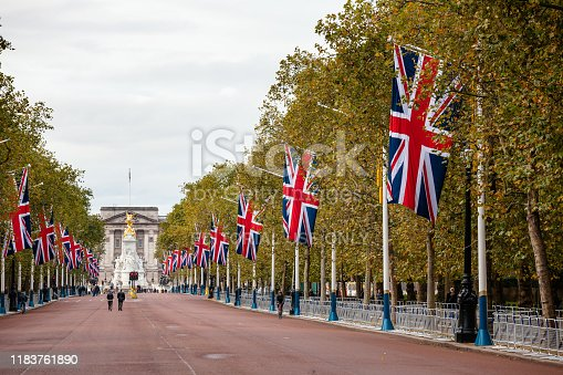 LONDON, UK - OCTOBER 28, 2012: A view along the Mall decorated with Union Jack flags towards Buckingham Palace