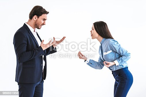 istock The man and a woman quarreling on the white background 986661956