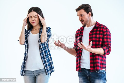 istock The man and a woman quarrelling on a white background 986657556