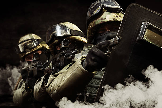 The man as member of the special forces with weapons stock photo