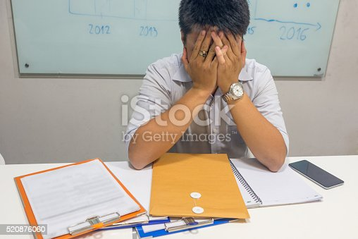 istock The man depressed by unexpected result at work 520876060