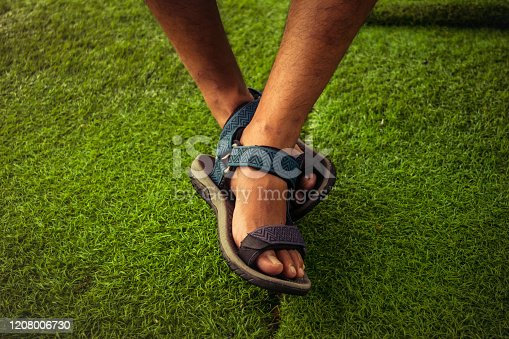 the man feet wearing sport sandals. selective focus