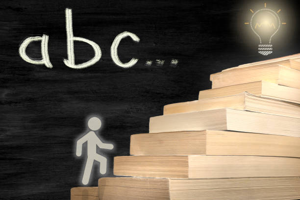 The man figure stepping books. reaching the target by reading. concept photo with abc text stock photo