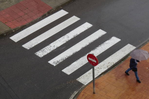 The man finishes crossing the street stock photo