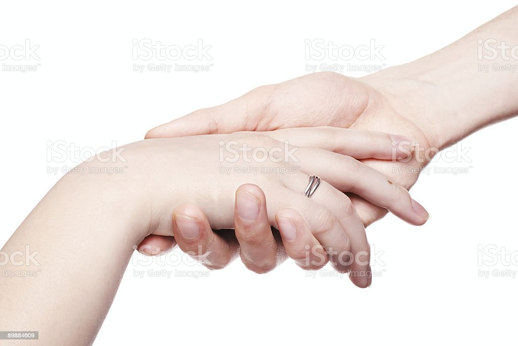 The man gently holds a female hand royalty-free stock photo