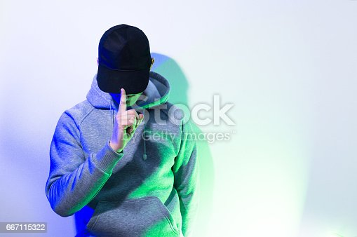 istock the man, guy in the blank black , baseball cap, grey hoody,  on a white background, mock up, free space, logo presentation , template for print,  design 667115322