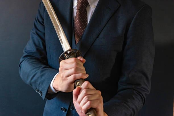 日本刀を持った男 - 営業 ストックフォトと画像