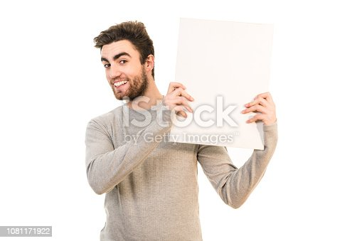 istock The man holds the blank paper on the white background 1081171922