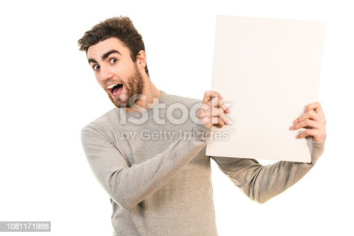istock The man holds the blank paper on the white background 1081171988