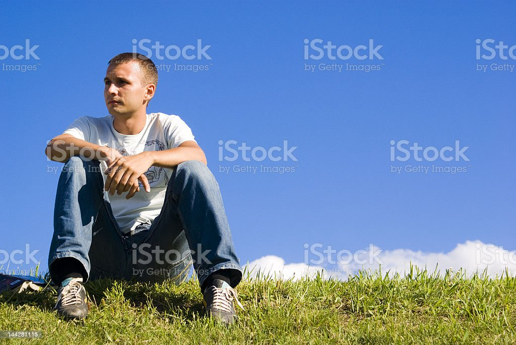 The man in a green meadow royalty-free stock photo