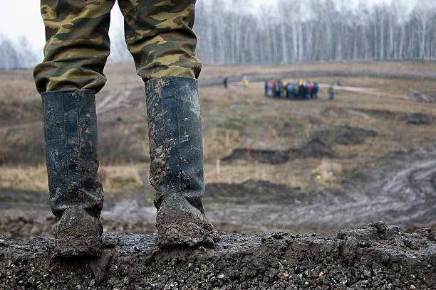 The man in muddy kersey boots. stock photo