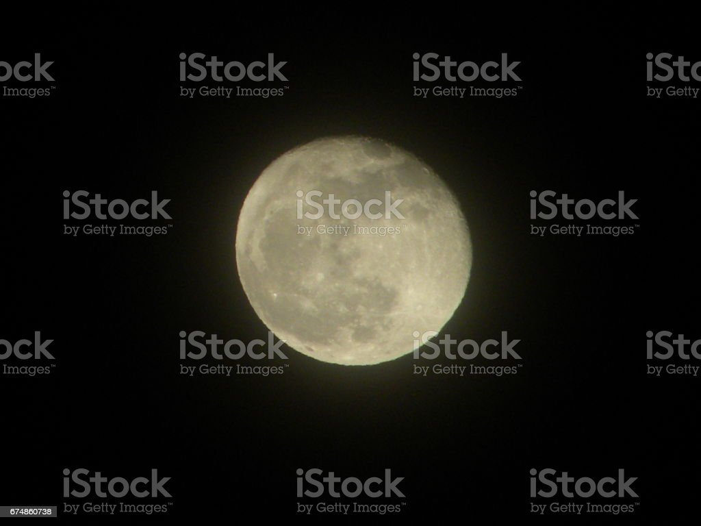 The Man in the Moon Watches Over You stock photo