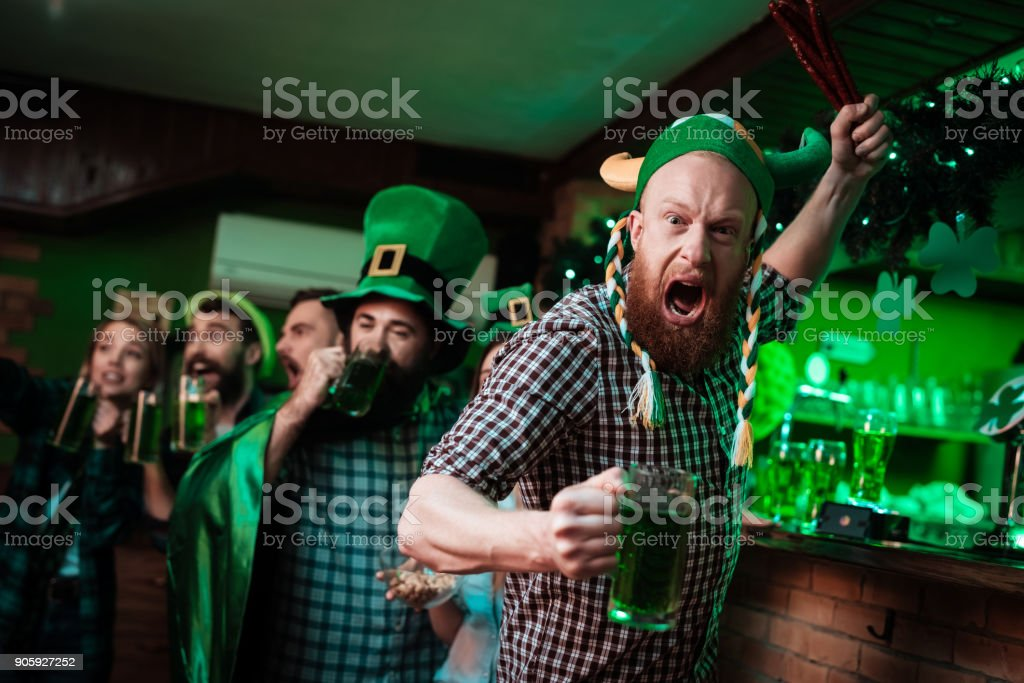 The man in the Viking hats is holding the sausages like a sword. stock photo