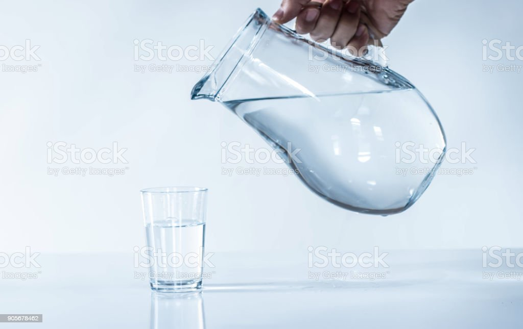 the man is filling water cup