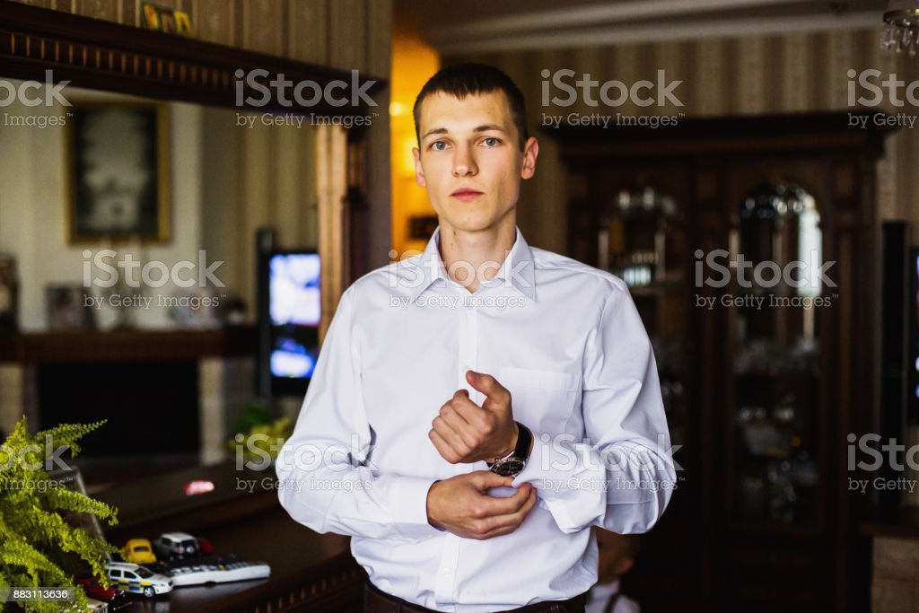 The man is going to work. Charges groom. Business portrait in an interior stock photo