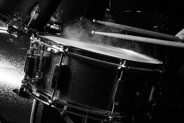 The man is playing drumset The man is playing drumset in low light background. drummer stock pictures, royalty-free photos & images