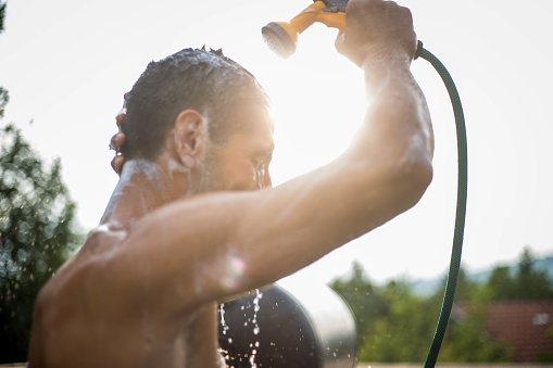 istock The man is showering in the yard 1011455542