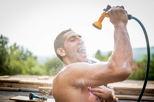 istock The man is showering in the yard 1011455564