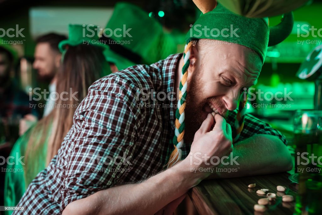 The man is trying to crack the nut. stock photo