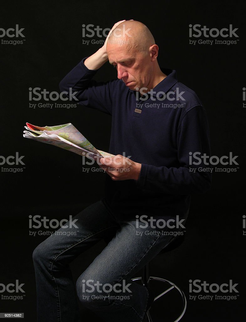 The man look into a map of China royalty-free stock photo