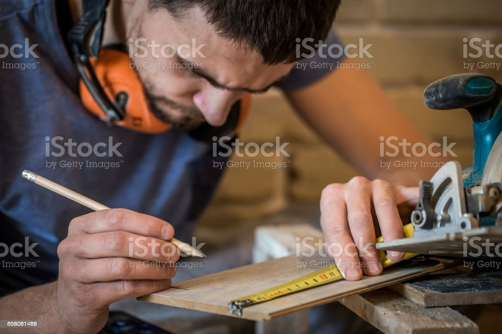 the man makes the measurements on the Board royalty-free stock photo
