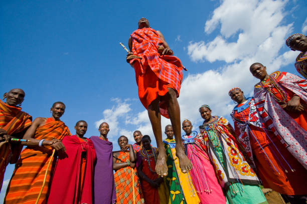 the man of a tribe masai shows ritual jumps. - kenyan culture stock photos and pictures