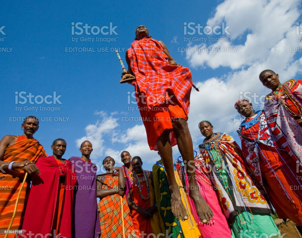 The man of a tribe Masai shows ritual jumps. stock photo