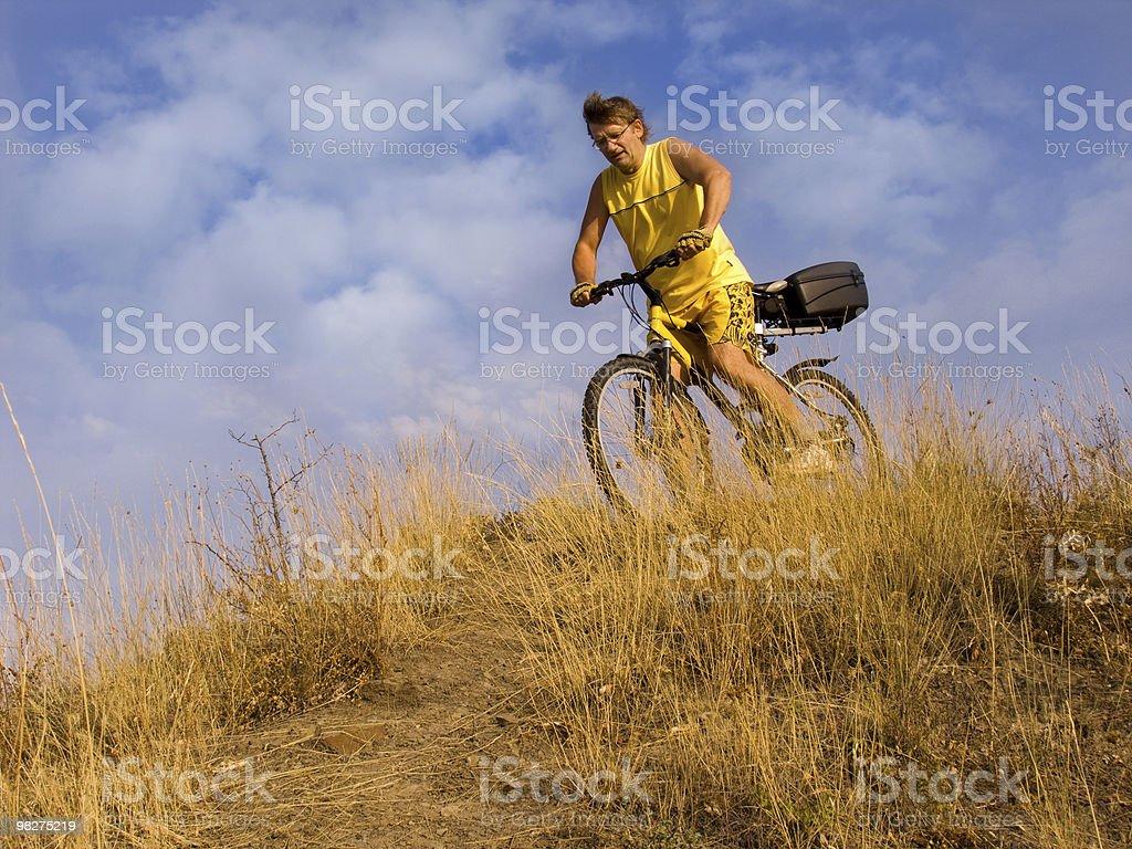 L'uomo in bicicletta foto stock royalty-free