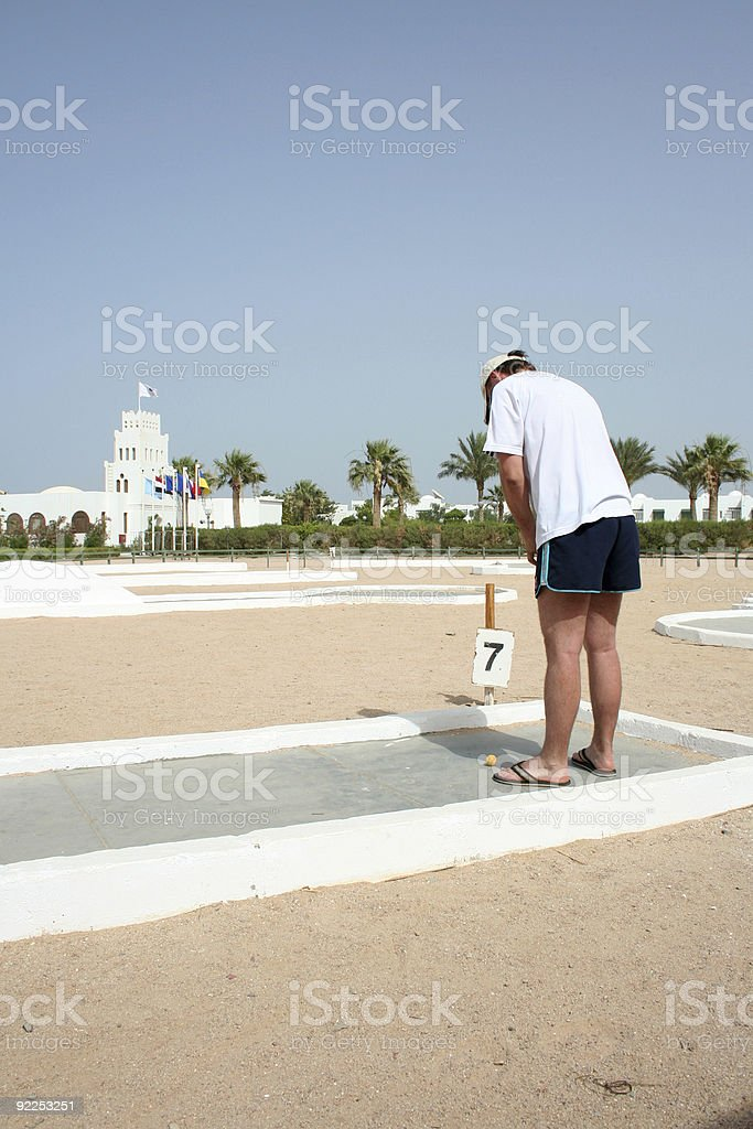The man plays a golf royalty-free stock photo