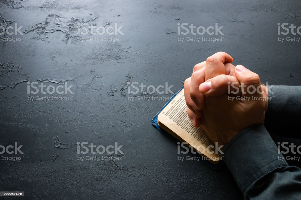 The man prays in the bible stock photo