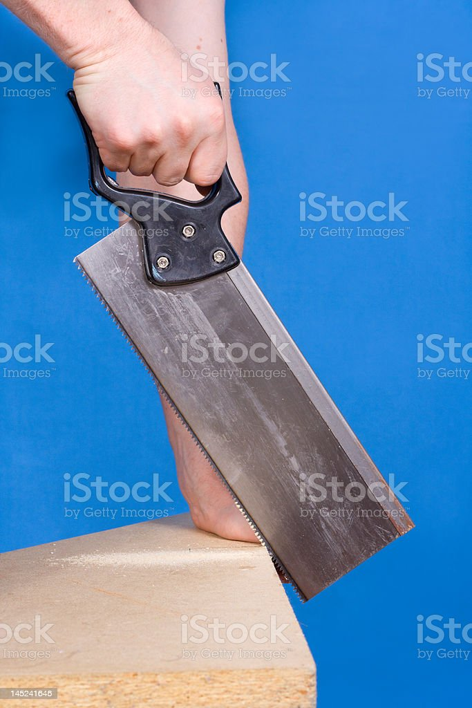 The man saws stock photo