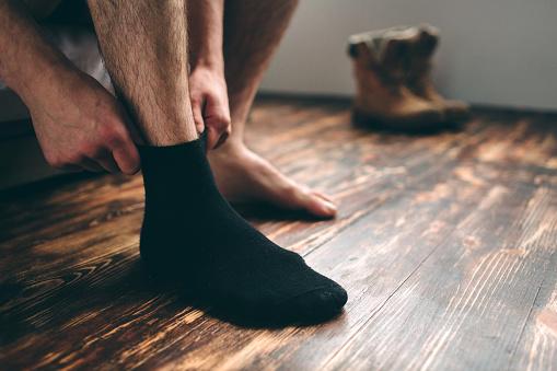 The man wears black socks. Men's style