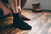 istock The man wears black socks. Men's style. 1138859354