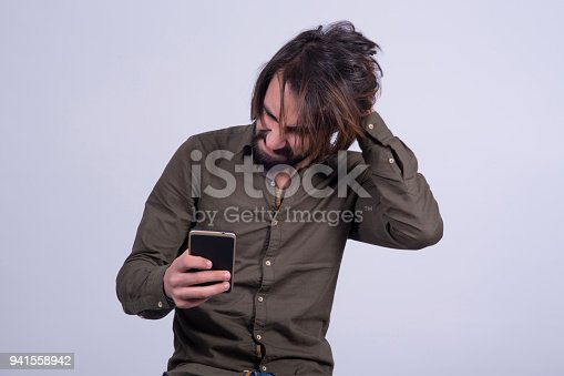 824614192 istock photo The man who is having trouble with the phone. 941558942